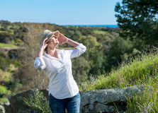 Woman in nature with sunl. Woman enjoying in nature with sun and holding arms up Stock Photos