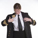 Woman navy officer dressing in her uniform jacket Royalty Free Stock Photography