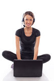 Woman in neadphones with laptop on a white Royalty Free Stock Images