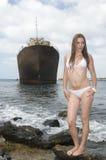 Woman near an abandoned ship with bikini Royalty Free Stock Image