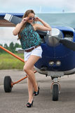 Woman near airplane Royalty Free Stock Images