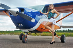 Woman near airplane Stock Images