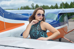 Woman near airplane Royalty Free Stock Photo