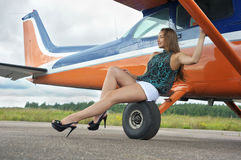 Woman near airplane Royalty Free Stock Photos