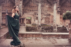 Woman near ancient ruins Royalty Free Stock Photos