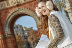 Woman near Arc de Triomf with map looking into distance Stock Photography