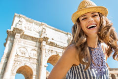 Woman near arch of constantine in rome, italy. Portrait of happy young woman near arch of constantine in rome, italy Royalty Free Stock Image