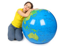 Woman near big inflatable globe with closed eyes Royalty Free Stock Photos