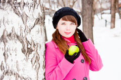 Woman  near a birch with a green apple in hands Stock Photo