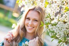 Woman near blossom tree Stock Photos