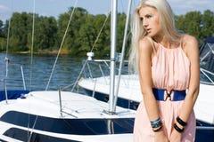 Woman near the boat Stock Photos