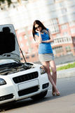 Woman near broken car calling for help Stock Photography