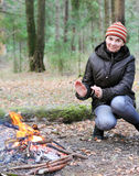 Woman near a campfire Stock Photo