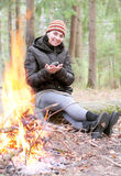 Woman near a campfire Stock Image