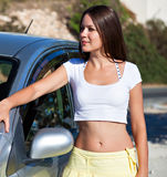 A woman is near the car Royalty Free Stock Images