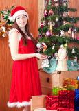 Woman near Christmas tree stock images