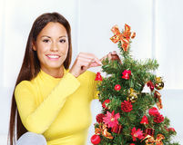 Woman near christmas tree Royalty Free Stock Photo
