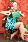 Woman near the Christmas tree Royalty Free Stock Photo