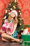 Woman near the Christmas tree Stock Image