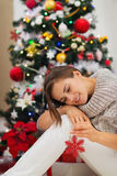Woman near Christmas tree playing with toy Stock Photo