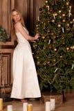 Woman near Christmas tree Stock Image