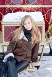 Woman near a coach in a winter park Stock Image
