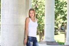 Woman near column in park Stock Image