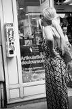 Woman near condoms distributor Royalty Free Stock Photos