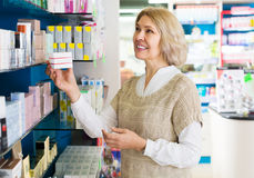 Woman near counter in pharmacy Stock Photography