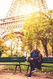 Woman near Eiffel tower in fall. Middle age, pretty woman near Eiffel tower in fall Royalty Free Stock Image