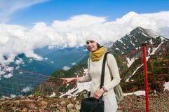Woman near the fence on the ski slopes in summer. Ski resort Sochi Royalty Free Stock Photo
