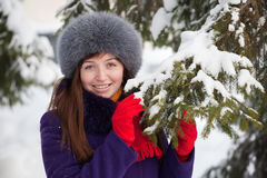 Woman near fir-tree in winter Royalty Free Stock Photography