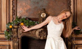 Woman near the fireplace Royalty Free Stock Photography