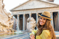 Woman near fountain of the pantheon in rome Stock Images