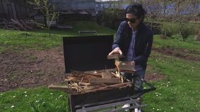Woman near grill at outdoor. In summer day stock video footage