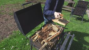 Woman near grill. In summer day stock footage