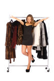 Woman near the hanger with a fur coats Royalty Free Stock Image