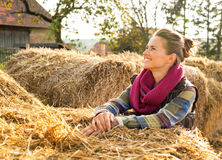 Woman near haystack looking on copy space Royalty Free Stock Image
