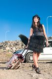 Woman near her broken car with bag Royalty Free Stock Photos