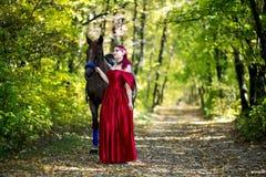 Woman near horse stock image