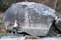 Woman near of huge boulder Royalty Free Stock Image