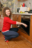 Woman near kitchen oven Stock Photo