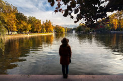 Woman near the lake at autumn park Royalty Free Stock Image