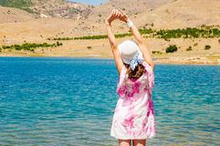 Woman near the lake in desert Royalty Free Stock Photo