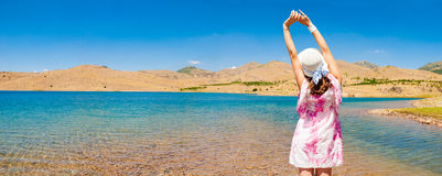 Woman near the lake in desert Royalty Free Stock Image