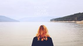 Woman near a lake with Follow Your Dreams text stock footage