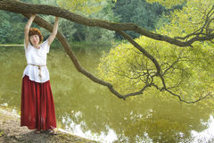 Woman near lake with willow Stock Image