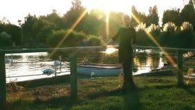 Woman near the Lake. Young blond woman near the dreamy lake stock video