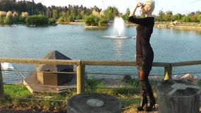 Woman near the Lake. Young blond woman near the dreamy lake stock footage
