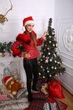Woman near x-mas tree. Beautiful woman near x-mas tree, happy New Year party Royalty Free Stock Images
